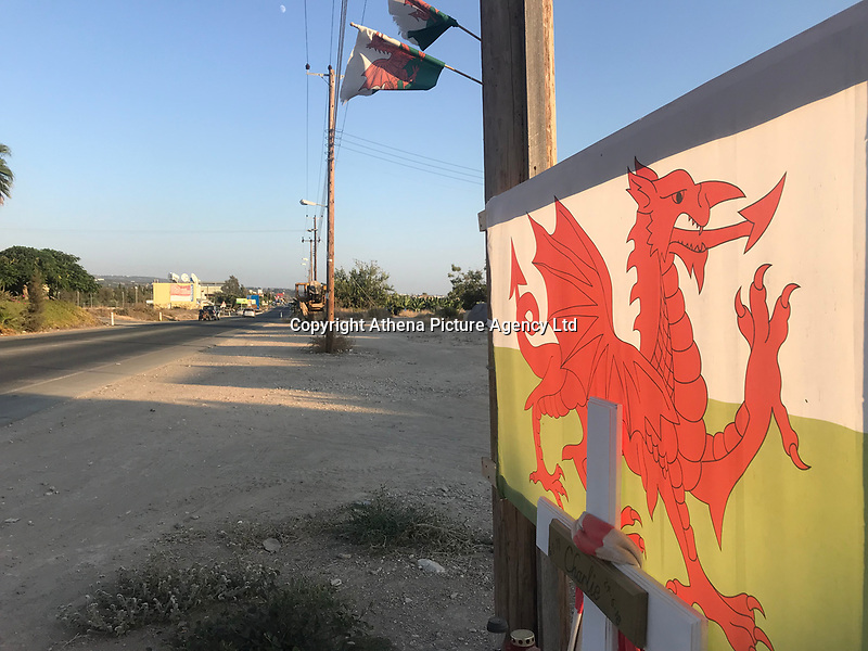 "Pictured: A welsh flag and tributes are left on the spot where Robert ""Charlie"" Birch was killed on a road in Pafos, Cyprus. Wednesday 19 September 2018<br /> Re: A man charged with the murder of Welsh holidaymaker Robert Birch, who is known as Charlie, has appeared in court in Cyprus.<br /> 39-year-old Charlie Birch, was killed in a hit-and-run crash, on the Peyia-Ayios Georghios road in Paphos in the early hours of the morning. Another man, aged 32, was injured.<br /> Under Cypriot law, the defendant can not be identified."