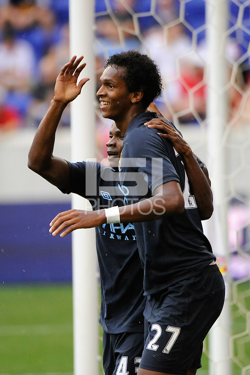 Jo Silva (27) of Manchester City F. C. celebrates scoring with Alex Tchuimeni-Nimely (43). The New York Red Bulls defeated Manchester City F. C.2-1 during a Barclays New York Challenge match at Red Bull Arena in Harrison, NJ, on July 25, 2010.