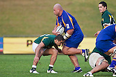 Patrick Kapi  goes low in an attempt to stop the hard charging Akerei Malesala. Oceania Cup & RWC Qualifier rugby game between the Cook Islands & Niue played at Growers Stadium, Pukekohe, on Saturday 27th June 2009. The Cook Islands won 29 - 7 after leading 9 - 7 at halftime.