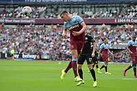 Declan Rice of West Ham United heads clear during West Ham United vs Manchester City, Premier League Football at The London Stadium on 10th August 2019