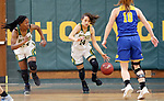 WATERBURY CT. 16 February 2018-021619SV17-#14 Maeve Perrone of Holy Cross High brings the ball up the floor s #10 Megan Condo of Seymour High defends during the NVL girls basketball tournament in Waterbury Saturday.<br /> #24 Nadia French-Graham of Holy Cross High follows the play, at left. <br /> Steven Valenti Republican-American