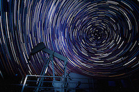 An oilwell with a background of startrails in the Cimarron National Grassland near Elkhart Kansas.