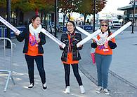 Volunteers cheering the racers on.