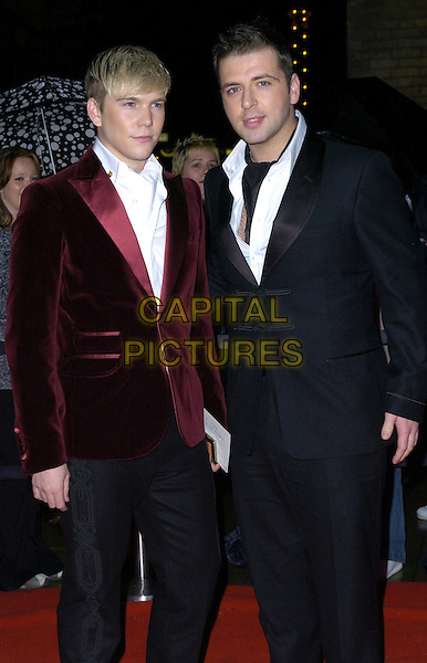 MARK FEEHILY (R) & GUEST.Arrivals - Emeralds & Ivy Ball, The Roundhouse, .London, England, December 1st 2006..half length 3/4.CAP/CAN.©Can Nguyen/Capital Pictures