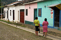 two middlleaged woman chatting on acobblestone street in the village of Ataco in western El Salvador