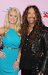 """BURBANK, CA - NOVEMBER 10: Jess Harnell and Christine Kellerman arrive at the Disney Channel's Premiere Party For """"Sofia The First: Once Upon A Princess"""" at the Walt Disney Studios on November 10, 2012 in Burbank, California."""