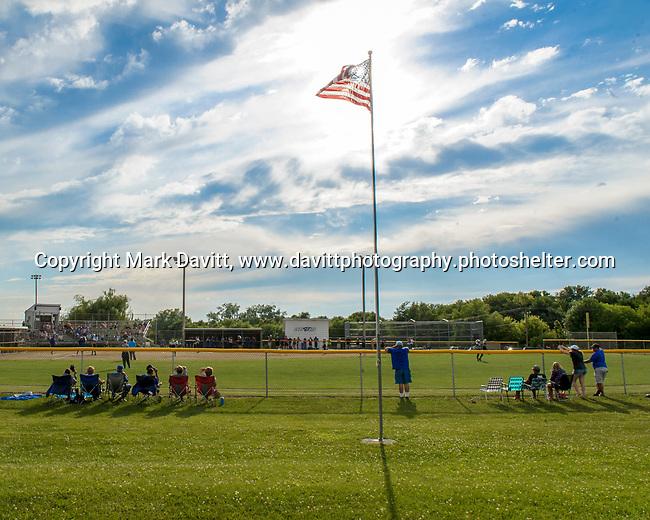 On a Fourth of July weekend the flag flies high as softball fans watch Bondurant-Farrar girls softball team fall to Grand View Christian June 30 at home.