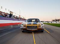 """Sep 2, 2016; Clermont, IN, USA; """"Papa John"""" Schnatter, founder of Papa Johns Pizza sits in his gold 1971 Camaro as he is towed back to the pits following to a charity race against NHRA top fuel driver Leah Pritchett qualifying for the US Nationals at Lucas Oil Raceway. Papa John's and DSR put up $10,000 each for Riley's Hospital for Children, adding $20,000 to funds already raised through pizza sales earlier in the day. Mandatory Credit: Mark J. Rebilas-USA TODAY Sports"""
