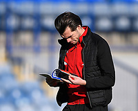 John Marquis of Doncaster Rovers reads the match programme during Portsmouth vs Doncaster Rovers, Sky Bet EFL League 1 Football at Fratton Park on 2nd February 2019