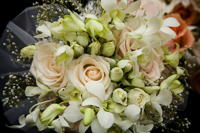 Close-up of bride's bouquet with roses.