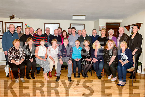 Pádraig Ó Braonáin Maor Scéim C.E Uibh Ráthaigh celebrates his retirement with his wife Breda, friends and co-worker's in Tig Rosie, Ballinskelligs, on Friday night last.