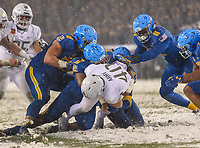 Philadelphia, PA - December 9, 2017:  Army Black Knights running back Andy Davidson (40) gets tackled by several Navy Midshipmen defenders during the 118th game between Army vs Navy at Lincoln Financial Field in Philadelphia, PA. (Photo by Elliott Brown/Media Images International)