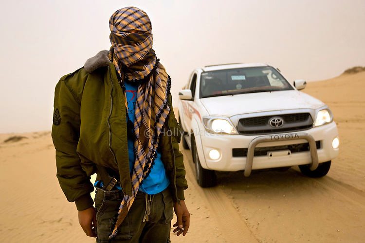 A Bedouin smuggler, armed with a Glock pistol, in the Sinai peninsula, Jan. 29, 2010. Some Bedouin make a living smuggling goods and humans from Egypt across the Gaza and Israel borders. A barrier wall being built buy Egypt may impact the illegal trade, causing strife between the government and Egypt's marginalized Bedouin tribes.