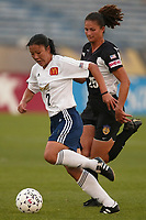 Zhang Ouying of the San Diego Spirit is chased by Jaclyn Raveia of the New York Power. The Spirit defeated the Power 1-0 on July 20th at Mitchel Athletic Complex, Uniondale, NY.