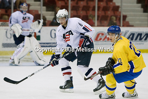 (Maxwell) Zach Bogosian (US White - 6), Mikael Backlund (Sweden 22) - Team Sweden defeated Team USA White 7-3 on Friday, August 8, 2008, in the 1980 Rink during the 2008 US National Junior Evaluation Camp and Summer Hockey Challenge in Lake Placid, New York.