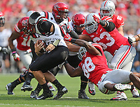 Ohio State Buckeyes defensive lineman Steve Miller (88) sacks San Diego State Aztecs quarterback Quinn Kaehler (18) in the first quarter of a football game between the Ohio State Buckeyes and the San Diego State Aztecs on Sept. 7, 2013 at Ohio Stadium. (Columbus Dispatch photo by Fred Squillante)