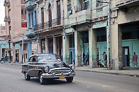 Cuba, Havana.  Early Morning Central Havana Street Scene, 1953 Buick.
