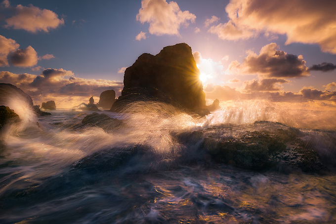 A not-often seen side of Cannon Beach, photographed amidst the violent waves of an incoming tide at sunset.<br />