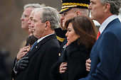 Former U.S. President George W. Bush and members of the Bush family watch as a joint services military honor guard carries the flag-draped casket of former U.S. President George H.W. Bush from the U.S. Capitol in Washington, Wednesday, Dec. 5, 2018. <br /> Credit: Shawn Thew / Pool via CNP