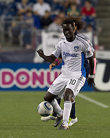 San Jose Earthquakes midfielder Simon Dawkins (10) passes the ball. In a Major League Soccer (MLS) match, the San Jose Earthquakes defeated the New England Revolution, 2-1, at Gillette Stadium on October 8, 2011.