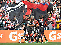 Rafael Teixeira (9) of D.C. United celebrates his score in the 22th minute of the game with teammates.  The Columbus Crew defeated D.C. United  2-1, at RFK Stadium, Saturday March 23, 2013.