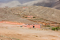 Dades Gorge, Morocco.  Village Houses on Hillside.  Village Soccer Field in Front.