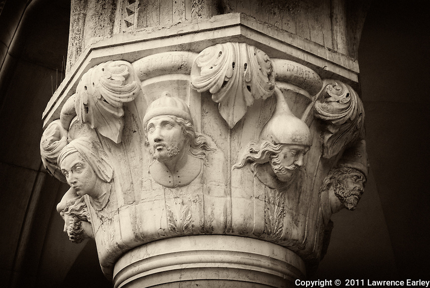 Another ornate capital on a column of the Doge's Palace in St. Marks Square, Venice.  Each bust has individual facial characteristics.