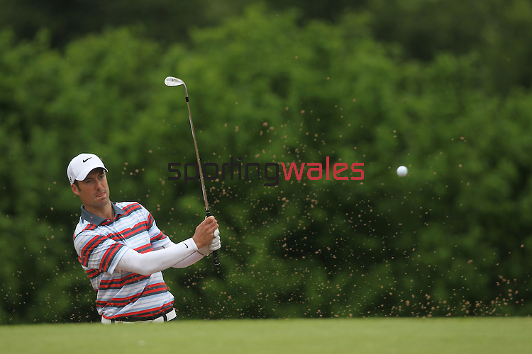 Ross Fisher splashes out of the sand on the 17th during the final round of the ISPS Handa Wales Open 2012..03.06.12.©Steve Pope