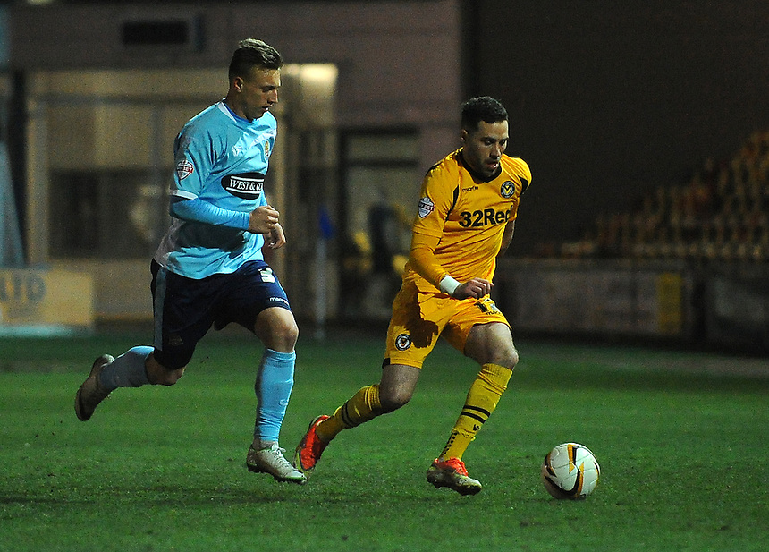 Newport County's Robbie Willmott under pressure from Dagenham and Redbridge's Luke Norris<br /> <br /> Photo by Kevin Barnes/CameraSport<br /> <br /> Football - The Football League Sky Bet League Two - Newport County AFC v Dagenham &amp; Redbridge - Wednesday 19th March 2014 - Rodney Parade - Newport<br /> <br /> &copy; CameraSport - 43 Linden Ave. Countesthorpe. Leicester. England. LE8 5PG - Tel: +44 (0) 116 277 4147 - admin@camerasport.com - www.camerasport.com
