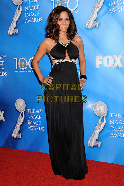 HALLE BERRY.40th Annual NAACP Image Awards - Press Room at the Shrine Auditorium, Los Angeles, California, USA..February 12th, 2009.full length long maxi black dress hands on hips silver beads beaded cut out away.CAP/ADM/BP.©Byron Purvis/AdMedia/Capital Pictures.