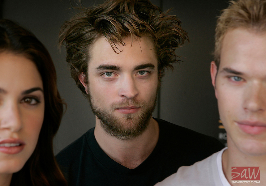 LOS ANGELES,CA - OCTOBER 08,2008: Three actors who will appear in the upcoming Twilight  movie. Robert Pattinson, center, Nikki Reed,left, and Kellan Lutz, right. Film is the big screen adaptation of the first installment in the wildly successful young adult book series by Stephenie Meyer. Photographed October 09, 2008.