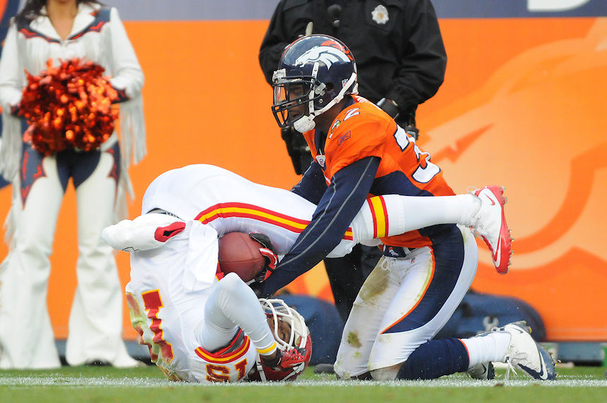 14 NOVEMBER 2010:   Chiefs wide receiver Verran Tucker is tackled awkwardly by broncos cornerback Perrish Cox during a regular season National Football League game between the Kansas City Chiefs and the Denver Broncos at Invesco Field at Mile High in Denver, Colorado. The Broncos beat the Chiefs 49-29.