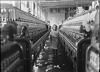 """Newberry, South Carolina , USA - 1908 December 3rd - <br /> <br /> : A little spinner in the Mollahan Mills, Newberry, S.C. She was tending her """"sides"""" like a veteran, but after I took the photo, the overseer came up and said in an apologetic tone that was pathetic, """"She just happened in."""" Then a moment later he repeated the information. The mills appear to be full of youngsters that """"just happened in,"""" or """" are helping sister."""" Dec. 3, 08. Witness Sara R. Hine. Location: Newberry, South Carolina / Photo by Lewis W. Hine."""