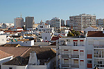 High density roof top view of  buildings crowded together in the city centre of Faro, Algarve, Portugal