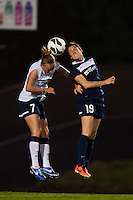Seattle Reign FC defender Elli Reed (7) goes up for a header with Sky Blue FC forward Kelley O'Hara (19). Sky Blue FC defeated the Seattle Reign FC 2-0 during a National Women's Soccer League (NWSL) match at Yurcak Field in Piscataway, NJ, on May 11, 2013.