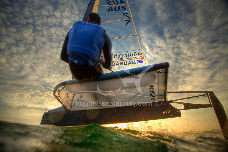 """Scott Babbage in a training session on his Moth Mach 2 in Sydney Harbour, Single-handed sailing dinghy with hydro-foils..Enter McConaghy Boats, builders of the """"Fastest Boats on the Planet"""". McConaghy Boats understand strong, light and fast and in no time at all McConaghy partnered with McDougall and began to build the next generation of foiling moths. Drawing upon the two names McDougall / McConaghy and acknowledging the name of the 2nd moth ever built by founder John McConaghy, they formed Mach 2 Boats Pty Ltd.."""