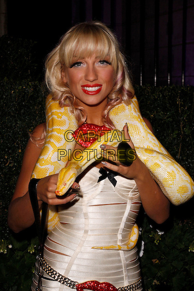 Georgina Leahy and Slinky Sebastian.UK Lingerie Awards, One Mayfair, London, England..September 19th, 2012.half length snake python animal pink strapless dress straps around shoulders red lips mouth lipstick  .CAP/AH.©Adam Houghton/Capital Pictures.
