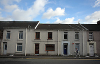 Pictured: A boy walks past terraced houses in Bridge Street in Llangennech, west Wales. Thursday 24 February 2017<br />