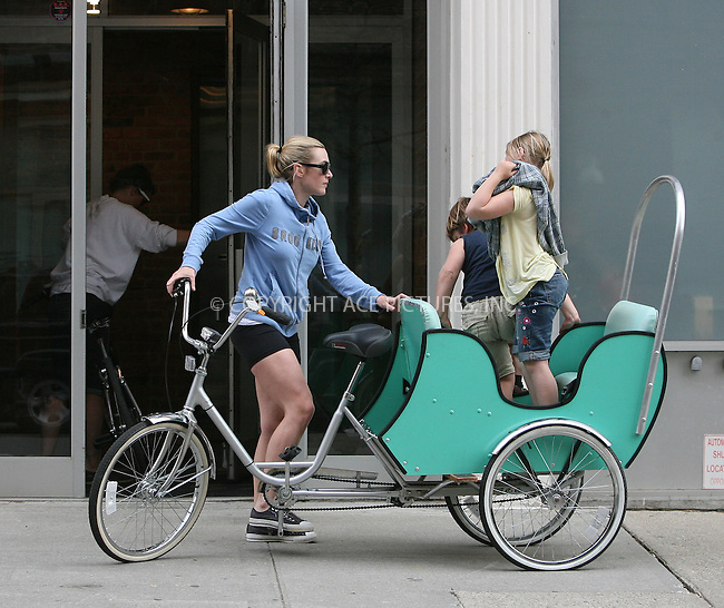 WWW.ACEPIXS.COM ************....**EXCLUSIVE - USAGE RATES MUST BE AGREED. PLEASE PHONE 646 769 0430**....April 6 2010, New York City....Actress Kate Winslet, who recently announced sa split from her second husband director Sam Mendes, arrives at her West Village apartment on a tricycle with her children Joe Alfie and Mia Honey on April 6 2010 in New York City......Please byline: PHILIP VAUGHAN - ACEPIXS.COM.. *** ***  ..Ace Pictures, Inc:  ..tel: (646) 769 0430..e-mail: info@acepixs.com..web: http://www.acepixs.com