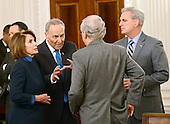 United States Senate Minority Leader Chuck Schumer (Democrat of New York), left center, engages in conversation with US House Minority Leader Nancy Pelosi (Democrat of California), left,  US Senate Majority Leader Mitch McConnell (Republican of Kentucky), center right, and US House Majority Leader Kevin McCarthy (Republican of California), right, prior to the arrival of President Donald Trump at a reception for US House and US Senate Republican and Democratic leaders in the State Dining Room of the White House in Washington, DC on Monday, January 23, 2017.<br /> Credit: Ron Sachs / Pool via CNP