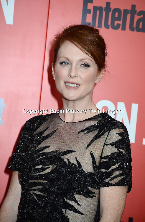 """Julianne Moore in black Jason Wu dress attends the """"Don Jon"""" New York Movie Premiere on September 12, 2013 at the SVA Theatre in New York City."""