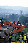 An environmental protester is removed from  a digger that  he has climbed on thus stopping it from working on  the planned Batheaston bypass Bath,  Solsbury Hill, Avon.