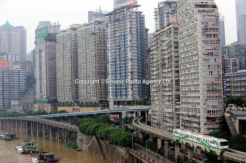 Chongqing metro train across high density apartments. .02 Aug 2009