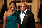 United States Representative Elijah Cummings (Democrat of Maryland) right, and Maya Rockeymoore Cummings arrive to a state dinner hosted by U.S. President Barack Obama and U.S. First Lady Michelle Obama in honor of French President Francois Hollande at the White House in Washington, D.C., U.S., on Tuesday, Feb. 11, 2014. Obama and Hollande said the U.S. and France are embarking on a new, elevated level of cooperation as they confront global security threats in Syria and Iran, deal with climate change and expand economic cooperation. <br /> Credit: Andrew Harrer / Pool via CNP