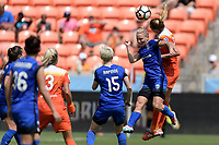 Houston, TX - Saturday May 27, 2017: Jess Fishlock and Cami Privett (23) of the Houston Dash go up for a header during a regular season National Women's Soccer League (NWSL) match between the Houston Dash and the Seattle Reign FC at BBVA Compass Stadium.