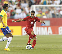 Portugal midfielder Joao Moutinho (8) dribbles. In an international friendly, Brazil (yellow/blue) defeated Portugal (red), 3-1, at Gillette Stadium on September 10, 2013.