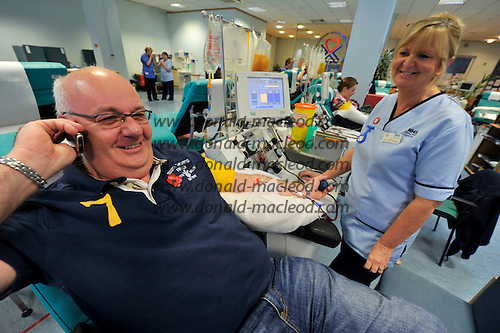 Blood Transfusion Centre - Glasgow - a business call for Ian Andrew while donating platelets - picture by Donald MacLeod – 10.11.11 – clanmacleod@btinternet.com 07702 319 738 donald-macleod.com