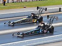 Jun 18, 2017; Bristol, TN, USA; NHRA top fuel driver Scott Palmer (near) races alongside Tony Schumacher during the Thunder Valley Nationals at Bristol Dragway. Mandatory Credit: Mark J. Rebilas-USA TODAY Sports