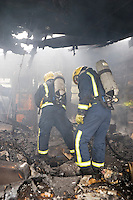Firefighters wearing Breathing Apparatus inside a static home to dealing with a severe fire. This image may only be used to portray the subject in a positive manner..©shoutpictures.com..john@shoutpictures.com