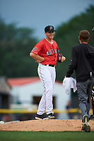 Batavia Muckdogs pitcher Brock Love (32) talks with athletic trainer Jordan Wheat during a NY-Penn League game against the Lowell Spinners on July 11, 2019 at Dwyer Stadium in Batavia, New York.  Batavia defeated Lowell 5-2.  (Mike Janes/Four Seam Images)